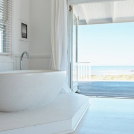 white wooden blinds in a bathroom